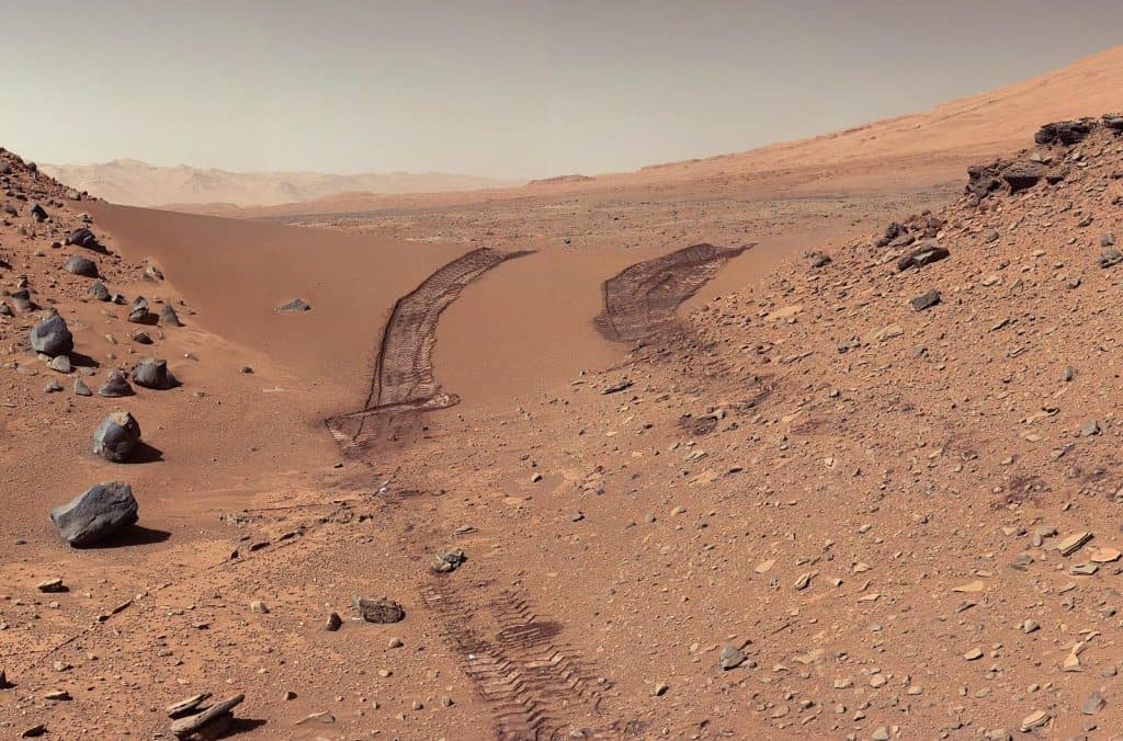 Rover tracks in dust on the surface of Mars
