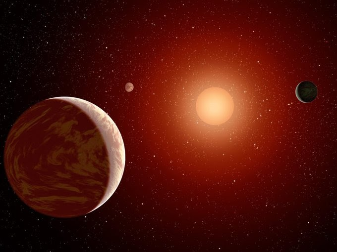 This NASA image shows three planets orbiting a red dwarf