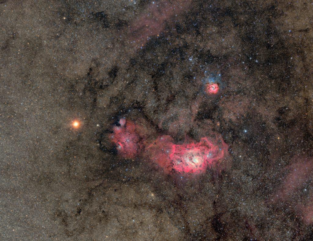 Mars seen approaching the Trifid Nebula